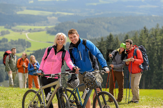 Sporty cyclist couple hikers springtime weekend