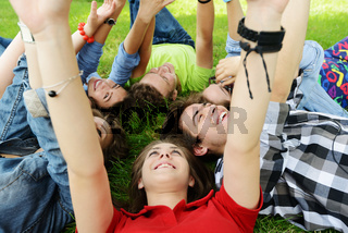 Group of friends lying on meadow