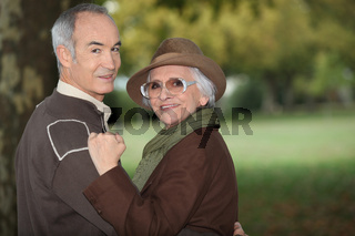 A mature couple in a park.
