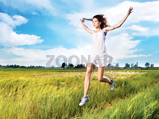woman running across field
