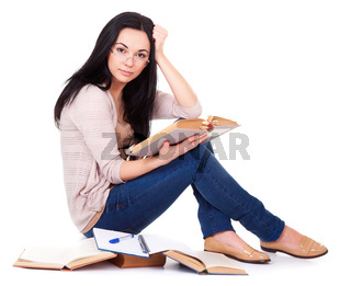 Charming young woman with books