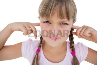 Little girl clogging her ears