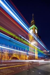Big Ben behind light beams at twilight time, London, UK