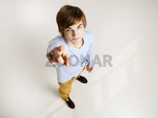 Young man pointing
