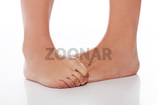 Embarrassede fmale hiding her feet