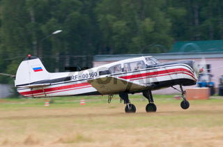 Yak-18t plane runs for takeoff