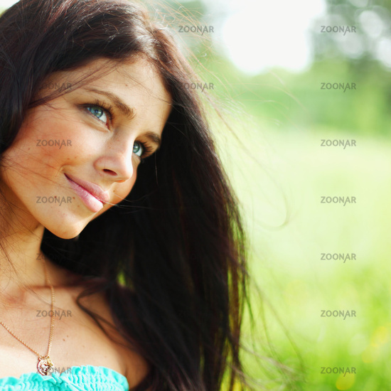 Beautiful Healthy Woman over Nature background