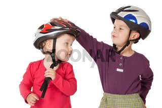 childs in bicycle helmets