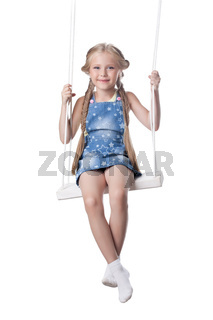 Happy girl sitting on swing