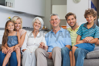 Extended family sitting on couch in living room