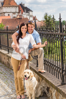 Young couple with dog at historical town