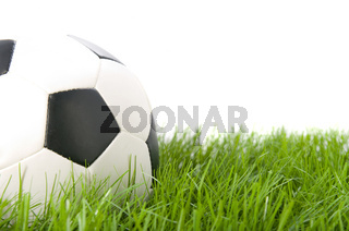Football ball on grass. Isolated.