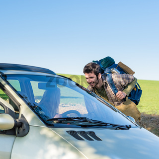 Hitch-hiking getting lift young woman in car