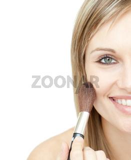 Radiant woman using a powder brush