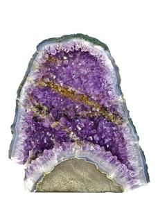 Rock purple quartz crystal isolated on white