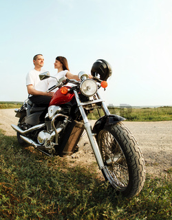 Young biker couple on the country road