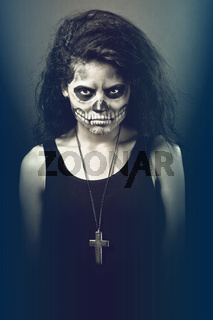 Young woman in day of the dead mask skull. Halloween face art