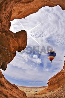 The balloon flies above slot-hole canyon