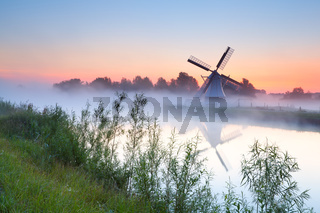 charming Dutch windmill by river