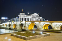 beautiful old stone bridge and archeological museum of Macedonia on star sky and moon