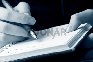 Female hand writing