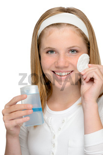 Cheerful smiling girl removing cleaning make-up face