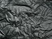 Crumpled cloth texture closeup background.