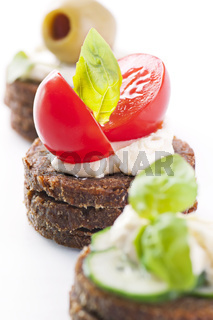 Canapes with tomato and feta