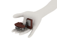 Office furniture in his outstretched palm