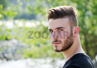 Portrait of attractive young man outdoors