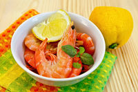 Shrimp in a white bowl with lemon