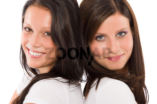 Two girlfriends beautiful model smiling portrait