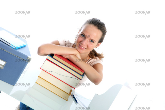 Confident student with textbooks