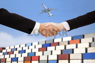 international business trade and transportation concept.businessman and businesswoman handshaking with containers background