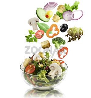 Vegetables Falling Into A  Salad Bowl