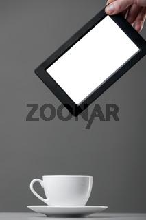 White mug and tablet computer