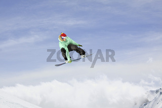 Snowboarder jumping high in the sky