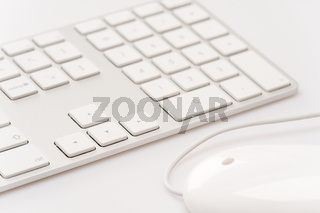 White keyboard with computer mouse