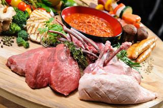 Abundance of raw food on a wooden board