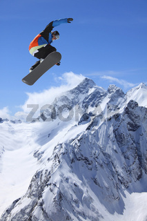 Snowboarder in high mountains