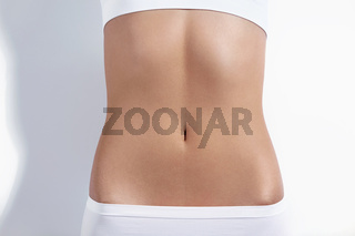 Nice tight belly on a white background