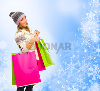 Young girl with bags on winter background