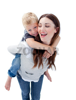Joyful mother giving her son piggyback ride