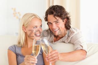 Beautiful couple making a toast