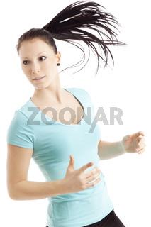 Sportliche Läuferin wirft einen Blick zur Seite