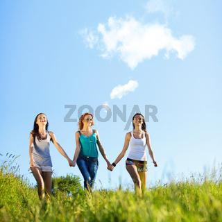 fun smile girlfriends run by green field sun is shine
