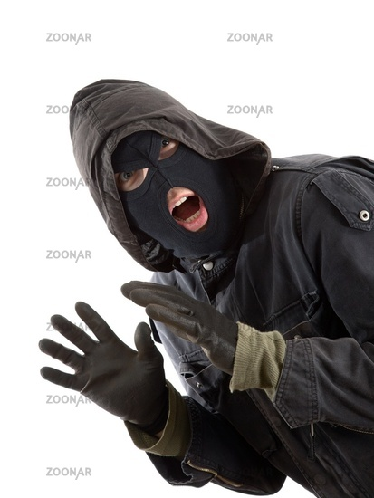 Surprised robber in a black mask