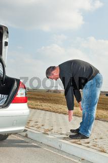 Man doing gymnastics next car