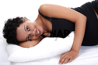 Beautiful pregnant woman lying on bed