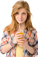 Pretty girl drinking juice with straw